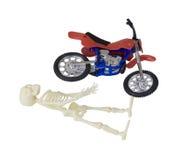 Skeleton laying next to Motorcycle Royalty Free Stock Image