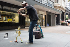 Skeleton marionatte. Auckland - February 17, 2017: A man is playing with his skeleton marionette on the street Stock Photo
