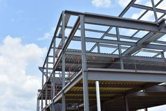 Skeleton of metal building under construction is shown Stock Photography