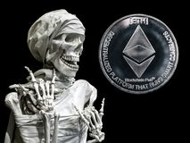 Skeleton model of the man and coin ETH stock photos