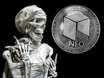 Skeleton model of the man and coin Neo stock images