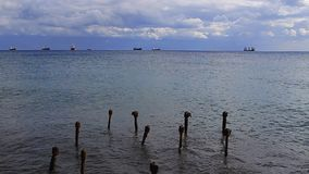 The skeleton of the old pier. The skeleton of the old pier and ships at sea. Mediterranean Sea. The island of Cyprus. Limassol's seafront promenade stock video footage