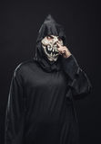 Skeleton picks his nose Royalty Free Stock Photos