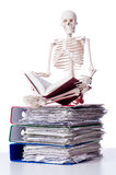 Skeleton with pile of files. On white Royalty Free Stock Photo