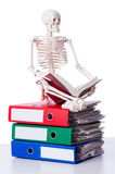 Skeleton with pile of files Stock Photo