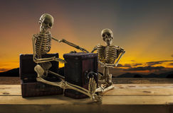 Skeleton pirate sitting on a treasure chest and old wood floor, Royalty Free Stock Images