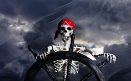 Skeleton Pirate Steering Ship Wheel Royalty Free Stock Photo