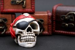 Skeleton pirate with treasure chest. On dark background royalty free stock photography