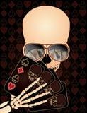 Skeleton playing poker Stock Photography