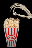 Skeleton with popcorn Stock Photos