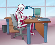 Skeleton posture at the computer Stock Image