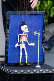 Skeleton puppeteer. Singing in the street Royalty Free Stock Photography