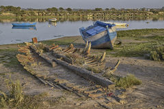 Skeleton. Remains of a traditional fishing boat rests with other abandoned ships end up in the same state Royalty Free Stock Photography
