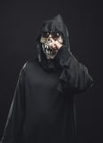 Skeleton in a robe picks his nose Royalty Free Stock Images