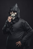 Skeleton in a robe picks his teeth Stock Photography