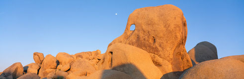 Skeleton Rock and Moon at Sunset, Royalty Free Stock Image