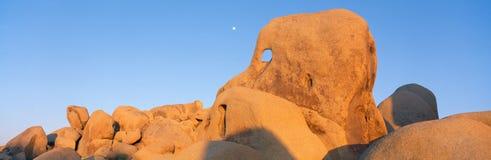 Skeleton Rock and Moon at Sunset, Joshua Tree, California Stock Photo