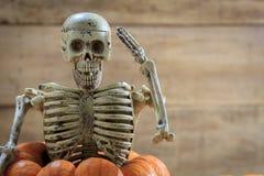 skeleton-saluting-pumpkin-blur-backgroun