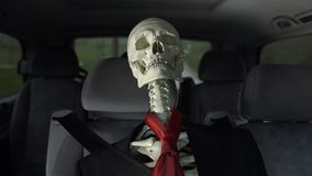 Skeleton on seat of a moving car stock video
