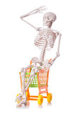 Skeleton with shopping cart trolley isolated Royalty Free Stock Image