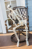 Skeleton sit at the armchair and wait Royalty Free Stock Image