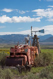 Skeleton sitting on a vintage tractor in Utah with mountains. In the background Stock Images