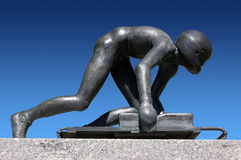 Skeleton - Sledding - Luge - Winter Olympic Sports. Bronze sculpture depicting the Olympic sport of Skeleton Royalty Free Stock Images