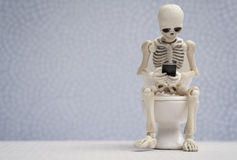 Skeleton with a smartphone Royalty Free Stock Image
