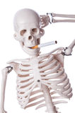 Skeleton smoking cigarette Royalty Free Stock Photography