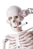 Skeleton smoking cigarette isolated Royalty Free Stock Photo