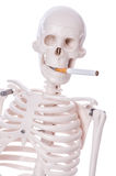 Skeleton smoking cigarette Stock Image