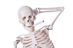 Skeleton smoking cigarette Royalty Free Stock Photos