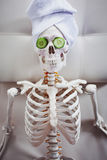 Skeleton in Spa salon with towel on her head and mask on her face. Stock Image