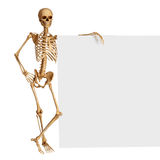 Skeleton is standing near sign Stock Photography