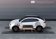 Skeleton view of electric SUV car exchange battery in battery swapping station. Fast battery exchange solution.  3D rendering image Stock Photos