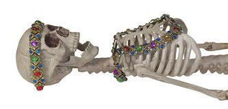 Skeleton Wearing Antique Gem Jewelry. Path included royalty free stock photo