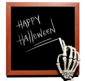 Skeleton writes Happy Halloween Stock Photo