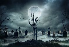 Free Skeleton Zombie Hand Rising Out Of A GraveYard Royalty Free Stock Photos - 158509408