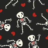 Skeletons and Hearts Pattern on Black Background Stock Image