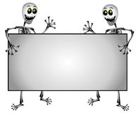 Skeletons Holding Blank Sign. A clip art illustration of a pair of halloween skeletons smiling and standing, holding a blank sign set on isolated white Stock Images