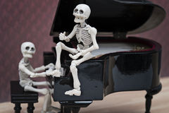 Skeletons pianist and diva Stock Images