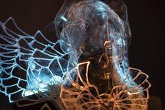 Skelett Crystal skalle som utformar med färgrika ljusa effekter, tra Fotografering för Bildbyråer