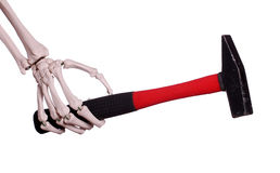 Skeletthand mit Hammer stockfotografie