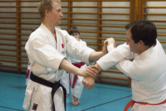Skelleftea, Sweden - February 7, 2011. Shotokan Karate practice with Sensei, Robin Nyholm and Tero Nyholm. Self defense techniques Stock Photography
