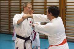 Skelleftea, Sweden - February 7, 2011. Shotokan Karate practice with Sensei, Robin Nyholm and Tero Nyholm. Self defense techniques Royalty Free Stock Images