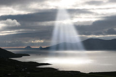 Skellig rocks sun beams Stock Photography