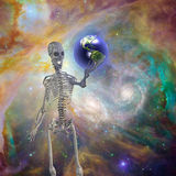 Skelton holds earth Stock Image
