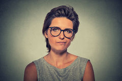 Skeptic. Doubtful woman in glasses looking at you. Skeptic. Doubtful upset angry woman in glasses looking at you camera isolated on gray wall background Royalty Free Stock Image
