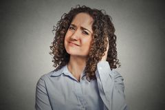 Skeptic. Doubtful woman looking at you Royalty Free Stock Photography