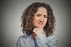 Skeptic. Doubtful woman looking at you Royalty Free Stock Photos